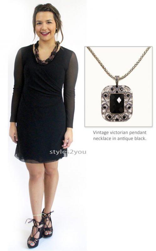 little black dress and pendant necklace